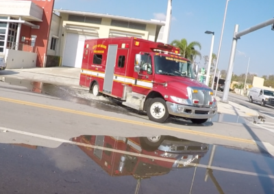 Fire Truck Leaves the Station as Tide Begins to Bubble Up Through the Storm Drains